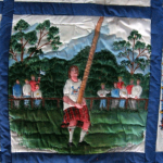 Quilt block of a caber being tossed