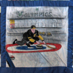 Quilt block of a man curling