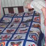 Mom checking out the panels on the quilt