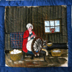 Quilt block of a woman with a spinning wheel