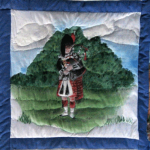 Quilt block with a Scottish bagpiper